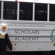 Baldy the Eagle and our new bus! in the spotlight